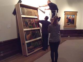 Pentecost by Sandro Botticelli and workshop being loaded into the crate to transport to London, photo by Catherine Nunn, 2016. © Victoria and Albert Museum, London