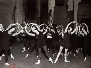 Ballets Russes dancers in an on-stage dance class, 1928. © Victoria & Albert Museum, London