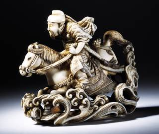 Photo of Netsuke of the Chinese General Gentoku riding across a river, carved ivory, signed Rakueisai, ca. 1850 – 1900, Japan. Museum no. A.781-1910. © Victoria and Albert Museum, London