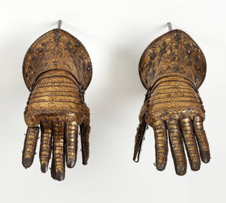 Photo of Pair of gauntlets, Lucio Piccinino, about 1585, Italy. Museum no. M.143 & A-1921. © Victoria and Albert Museum, London
