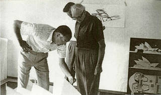 Jørn Utzon and Ove Arup with project engineer Povl Ahm discussing the roof structure in Utzon's studio, 1959, Hellebaek, Denmark. © Yuzo Mikami/Courtesy Arup