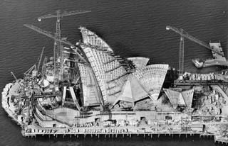 Robert Baudin, Sydney Opera House under construction, 1966. © Robert Baudin for Hornibrook Ltd, courtesy Australian Air Photos