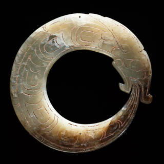 Photo of Jade dragon pendant, 1100 – 1000 BC, China. Museum no. A.73-1936. © Victoria and Albert Museum, London