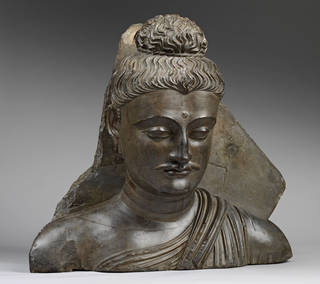 Plaster cast head of Buddha from Takht-i-Bahi, Pakistan, by students of the Mayo School of Industrial Arts, Lahore, Pakistan, about 1882-3. Museum no. IS.3311-1883. © Victoria and Albert Museum, London
