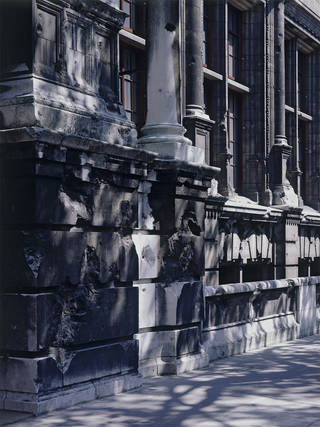 Photograph of the Aston Webb façade, Exhibition Road, showing bomb damage, 1996. Museum no. CT41656. © Victoria and Albert Museum, London