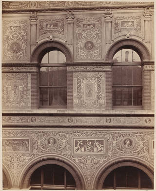 Photograph showing sgraffito (engraved plaster decoration) on the east side of the Science Schools (now Henry Cole Wing), designed by F.W. Moody and executed by students of the Art Schools, about 1870. Museum no. CIS 77778. © Victoria and Albert Museum, London