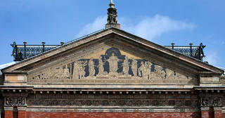 The pediment of the original Museum entrance, in 1865, now part of a façade in the John Madejski Garden. © Victoria and Albert Museum, London