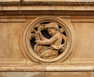 Detail of the frieze on the Victorian main façade, showing an infant gardener. © Victoria and Albert Museum, London