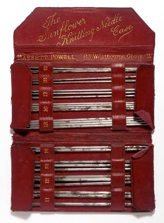 Photo of The Sunflower Knitting Needle Case, knitting needle case and knitting needles, Bassat Powell, 1870 – 90, England. Museum no. T.712:1 to 28-1995. © Victoria and Albert Museum, London