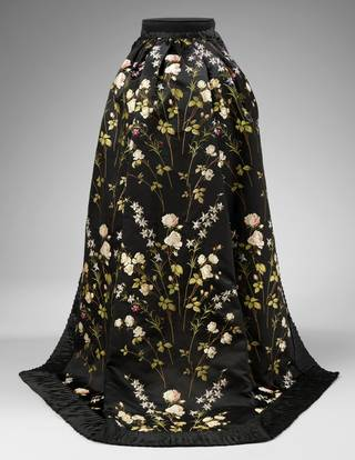 Black silk satin skirt trimmed with machine made lace and silk chiffon. Brocaded with roses and flowers