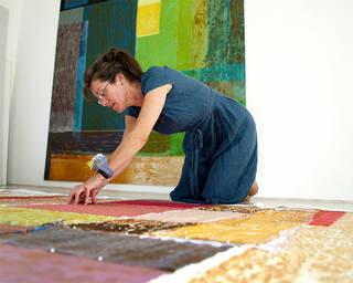 Jo Budd working in her studio, 2009. © Victoria and Albert Museum, London