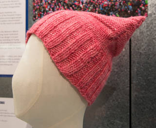 Pussyhat worn at the Women's March in Washington on 21 January 2017, designed by Krista Suh and Jayna Zweiman, and Kat Coyle, knitted by Jayna Zweiman, 2017, US. Museum no. PROV.611-2017. © Victoria and Albert Museum, London
