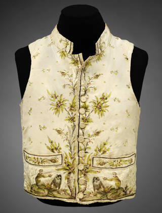 Silk waistcoat embroidered with silk in a pattern of monkeys, backed with linen