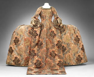 Mantua and petticoat of red silk brocaded with red, silver-gilt, silver, blue and brown in a large pattern of flowers