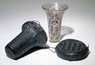 The Luck of Edenhall, beaker (shown with leather case), unknown, 14th century, probably Syria or Egypt. Museum no. C.1 to B-1959. © Victoria and Albert Museum, London