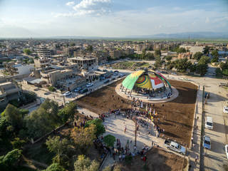 Overview of the New World Summit – Rojava, or 'People's Parliament of Rojava' during its opening on April 9