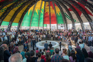 Moment of silence for the victims of the Turkish invasion of Afrin during the opening of the New World Summit – Rojava on April 9
