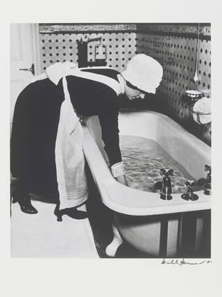 Parlourmaid preparing a Bath Before Dinner, photograph by Bill Brandt, 1939. © Bill Brandt Archive Ltd.