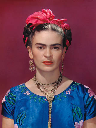 Frida Kahlo in blue satin blouse, 1939, photograph by Nickolas Muray. © Nickolas Muray Photo Archives.