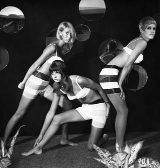 Black and white photograph of three models wearing Mary Quant striped shorts and white bras