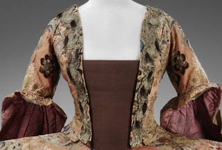 Court dress (mantua) (detail), woven silk trimmed with ermine tails, silk woven in France, dress made in Britain, 1760 – 5 with 19th-century alterations. Museum no. T.252&A-1959. © Victoria and Albert Museum, London