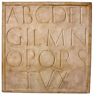 Plaster cast of the Trajan typeface, Eric Gill,  1919, England. Museum no. REPRO.6036. © Victoria and Albert Museum, London