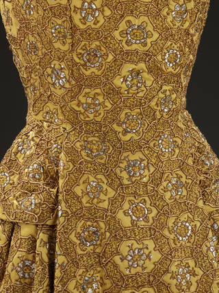 Photo of La Ligne H, evening ensemble (detail), designed by Christian Dior, embroidered by Bodin Brossin, 1954 – 55, France. Museum no. T.12&A-1977. © Victoria and Albert Museum, London