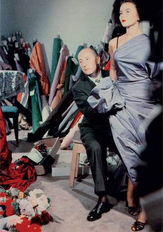 Photo of Christian Dior in a black suit, and model Sylvie in a blue dress