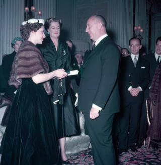 Photo of Princess Margaret presenting Christian Dior with a scroll