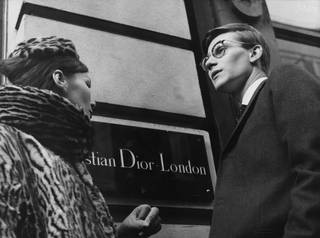 Black and white photo of Yves Saint Laurent in front of Christian Dior London