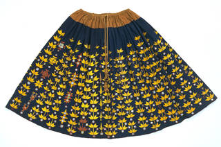 Skirt, indigo dyed cotton embroidered with yellow floss silk (phulkari), makers unknown, about 1867, Bannu, Pakistan. Museum no. 05668(IS). © Victoria and Albert Museum, London