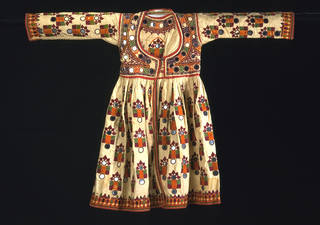 Boy's tunic, embroidered cotton with silks and applied mirrors, makers unknown, early 20th century, Sindh, Pakistan. Museum no. IS.18-1981. © Victoria and Albert Museum, London. Collection of the late Mr Justice Feroze Nana, given to the V&A by his widow and children.