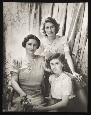 Queen Elizabeth, Princess Elizabeth and Princess Margaret at Buckingham Palace, photograph by Cecil Beaton, 1942, England. Museum no. Ph.677-1987. © Victoria and Albert Museum, London