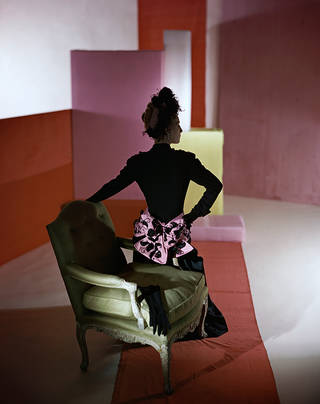 Photo of Dinner suit and headdress by Schiaparelli, 1947. © Condé Nast/Horst Estate