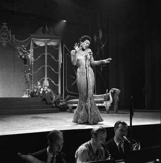 Eartha Kitt at the Palladium, photograph by Harry Hammond, 1957, England. Museum no. S.12480-2009. © Victoria and Albert Museum, London