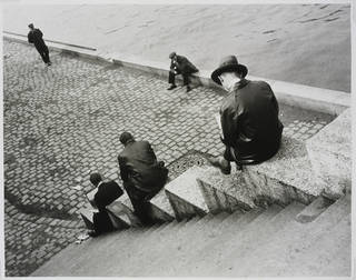 Three Men Sitting on the Steps by the Seine, photograph by Ilse Bing, photographed 1931, printed after 1931, Paris, gelatin silver print. Museum no. E.3032-2004. © Victoria and Albert Museum, London/Estate of Ilse Bing, courtesy Michael Mattis