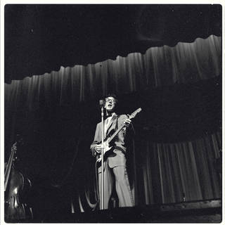 Photo of Buddy Holly at the London Palladium, photograph by Harry Hammond, 1958, England. Museum no. S.12027-2009. © Victoria and Albert Museum, London