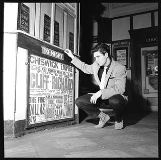 Photo of Cliff Richard at the Chiswick Empire foyer, photograph by Harry Hammond, 1959, England. Museum no. S.14383-2009. © Victoria and Albert Museum, London