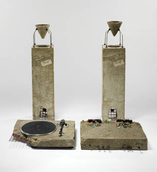 Concrete Stereo (stereo system set in concrete), Ron Arad, 1983. Museum no. W.7-2011. © Victoria and Albert Museum, London