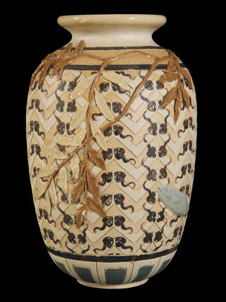 Vase, decorated to represent a pool with rectangular chevrons as stylised waves, painted tadpoles, naturalistic overhanging branches and celadon goldfish as if seen through water, modelled by  Harry Barnard, manufactured by Doulton Ceramic Factory, 1882, London. Museum no. C.54-1972. © Victoria and Albert Museum, London
