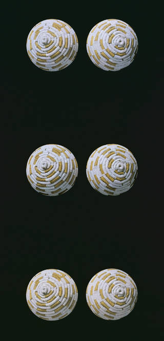 Photo of Portion of 'Tits in Space' wallpaper, designed by Sarah Lucas, manufactured by The Archive Printing Company Ltd., 2000, England. Museum no. E.832-2000. © Victoria and Albert Museum, London