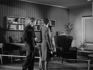 Still from 'Britain Can Make It No.12' (1946 Crown © / courtesy BFI), showing visitors admiring the Furnished Rooms exhibit.
