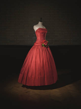 Red A Line dress with flowers at waist