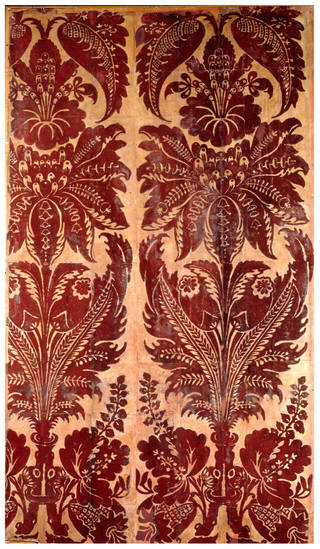 Panel of red flock wallpaper, identical in pattern with the paper formerly hung in the Queen's Drawing Room at Hampton Court Palace, unknown maker, about 1735, England. Museum no. E.3594-1922. © Victoria and Albert Museum, London