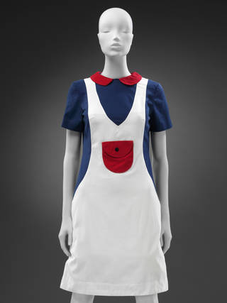 Minidress. Red round collar, blue sleeves and sides, white dress-like overlay over the top