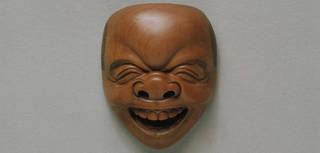 Carved: The Laughing Netsuke photo