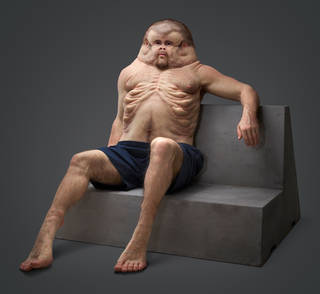 Model of what a man would have to look like to survive a car crash. He has a wide head/neck