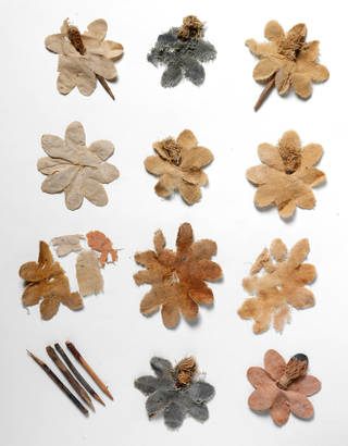Photo of Fragments of artificial flowers, 300 – 400 AD, Miran, China, cotton and silk with wooden pegs. Museum no. LOAN:STEIN.628. © Victoria and Albert Museum, London. On loan from the Government of India and the Archaeological Survey of India