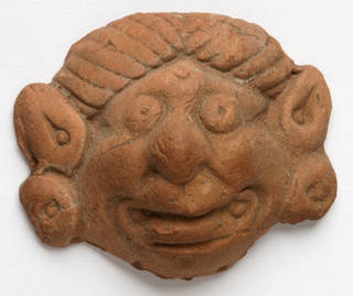 Photo of Head fragment, 200 – 500 AD, Xinjiang Uygur Zizhiqu, terracotta. Museum no. LOAN:INDIA.63. © Victoria and Albert Museum, London. On loan from the Government of India and the Archaeological Survey of India