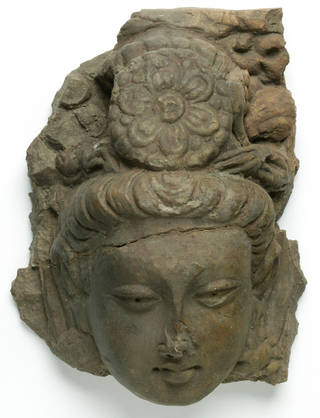 Photo of Head of a Bodhisattva, 500 – 600 AD, Xinjiang, China, moulded stucco. Museum no. LOAN:I A SURVEY.13. © Victoria and Albert Museum, London. On loan from the Government of India and the Archaeological Survey of India